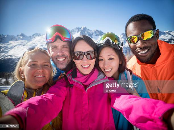 Group of friends skiing and taking a selfie