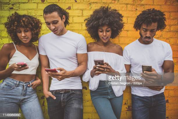 group of friends spending time togeher in new york city - meme stock pictures, royalty-free photos & images