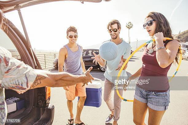 group of friends standing by car, holding picnic and play items - next to stock pictures, royalty-free photos & images