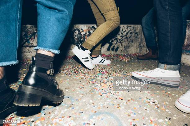 group of friends, standing outdoors, confetti on floor, low section - white women feet stock pictures, royalty-free photos & images
