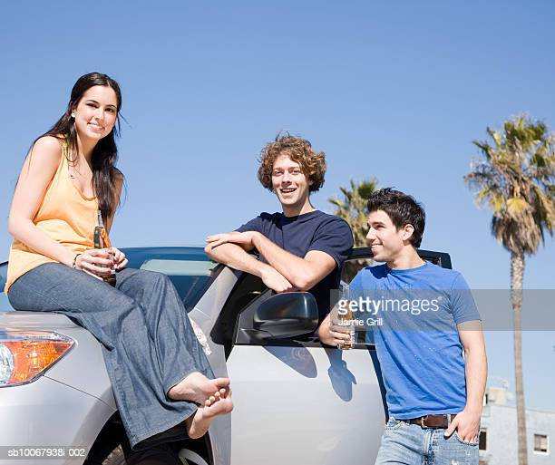 Group of friends tailgating by car