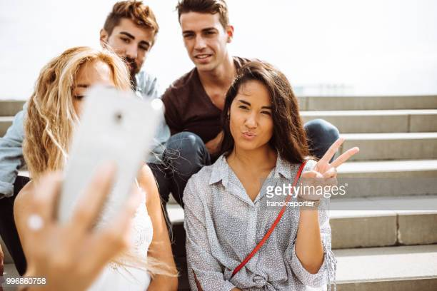 group of friends take a selfie all together in the steps