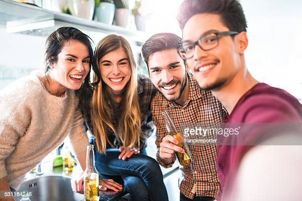 group of friends take a selfie during the party