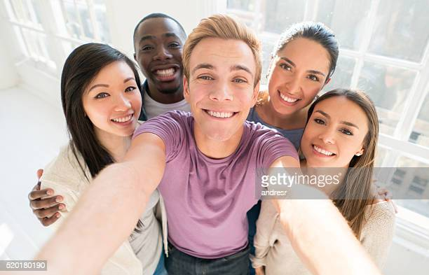 Group of friends taking a selfie indoors