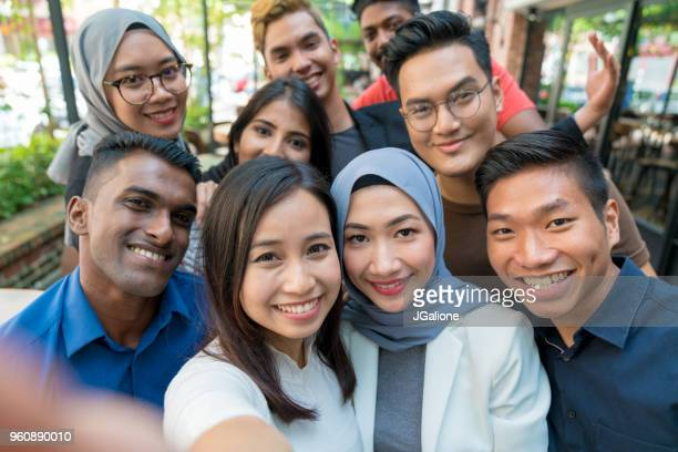 group of friends taking a selfie - malaysian culture stock pictures, royalty-free photos & images