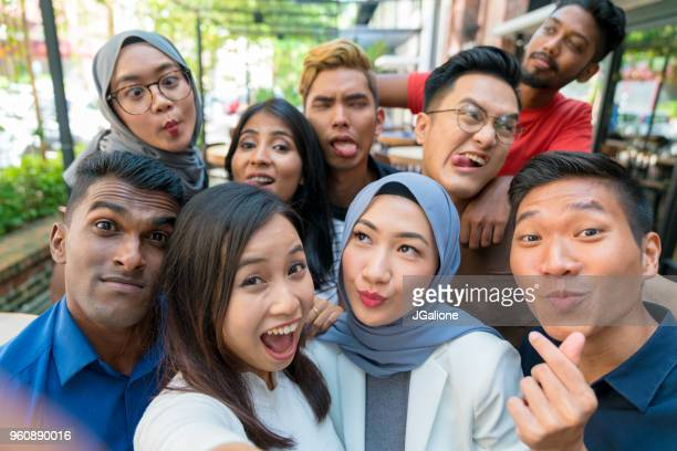group of friends taking a selfie - malaysia stock pictures, royalty-free photos & images