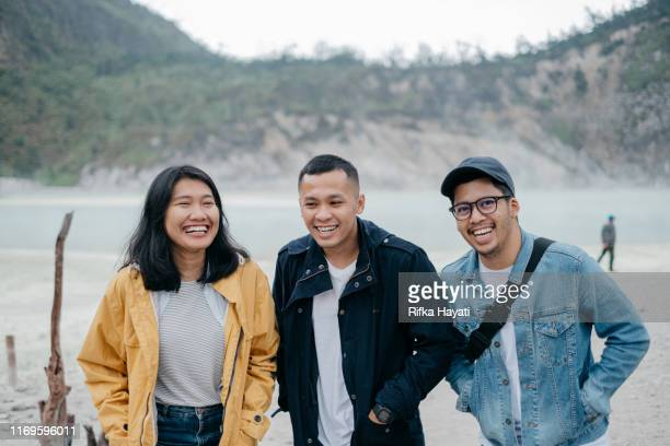 group of friends taking photo together while travelling - bandung stock pictures, royalty-free photos & images