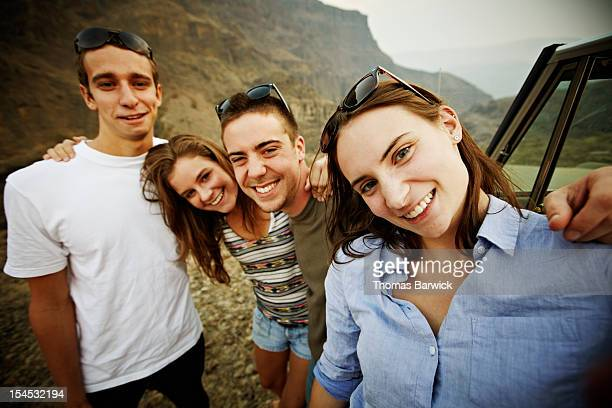 Group of friends taking self portrait with camera