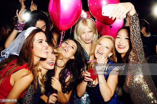 group of friends taking self portrait with phone - ladies' night stock pictures, royalty-free photos & images