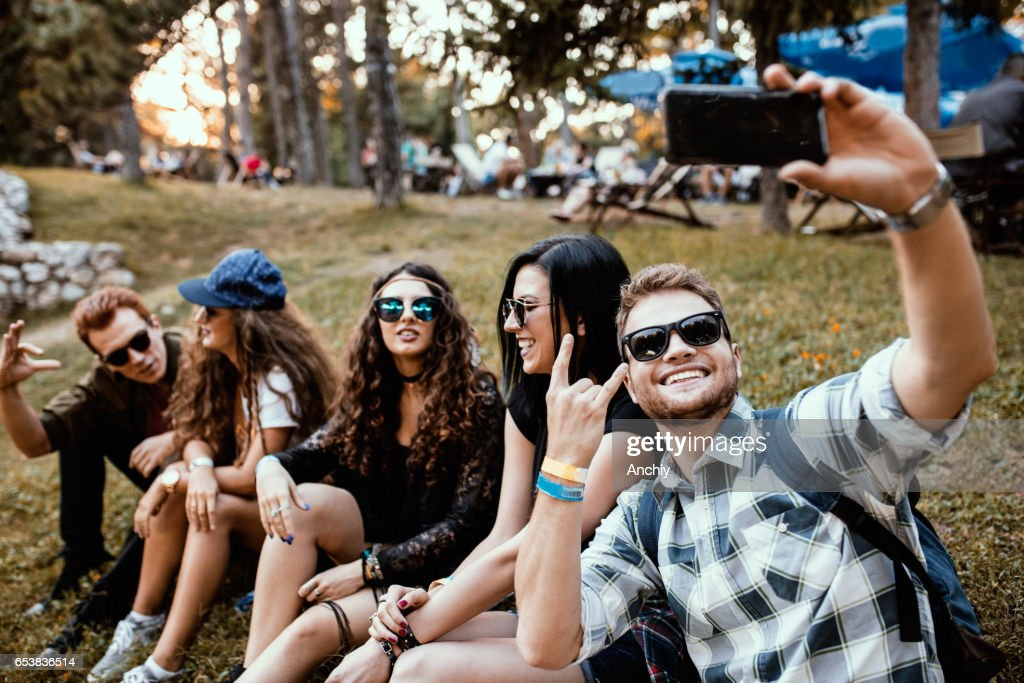 Group of friends taking selfie at Summer music festival : Stock Photo