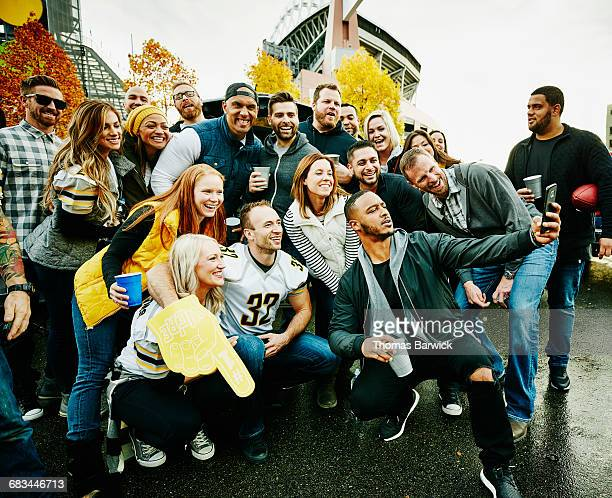 Group of friends taking selfie at tailgating party