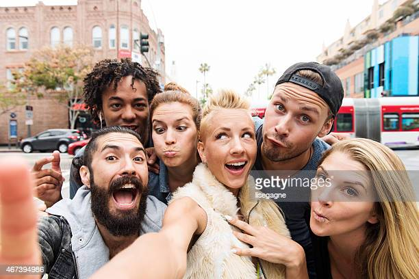 group of friends taking selfie - wide angle stock pictures, royalty-free photos & images