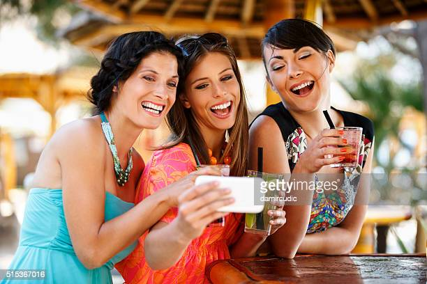 Group of friends taking selfies at the party