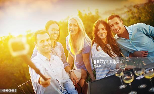 Group of friends taking selfies.