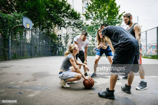 Group Of Friends Talking About Basketball Tactics Together