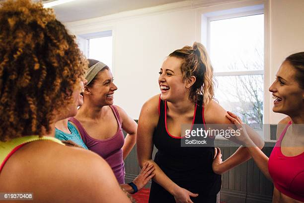 group of friends talking after fitness class - social gathering stock pictures, royalty-free photos & images