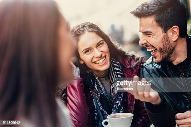 Group of friends talking and laughing