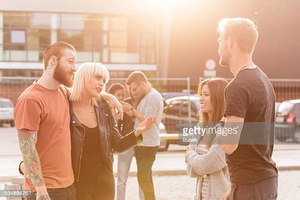 Group of friends talking outdoor