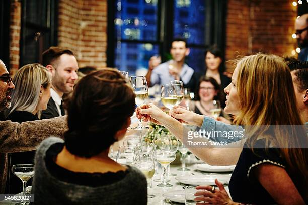Group of friends toasting at dinner party
