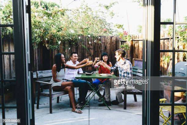 Group of friends toasting at garden party