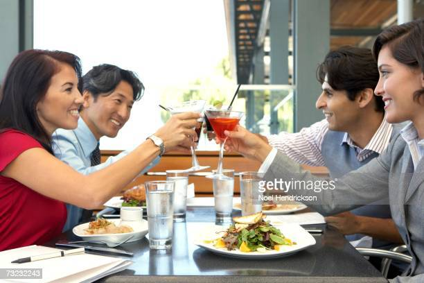 Group of friends toasting at restaurant