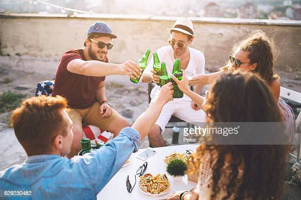 Group of friends toasting drinks outdoors