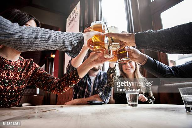 group of friends toasting - happy hour stock pictures, royalty-free photos & images