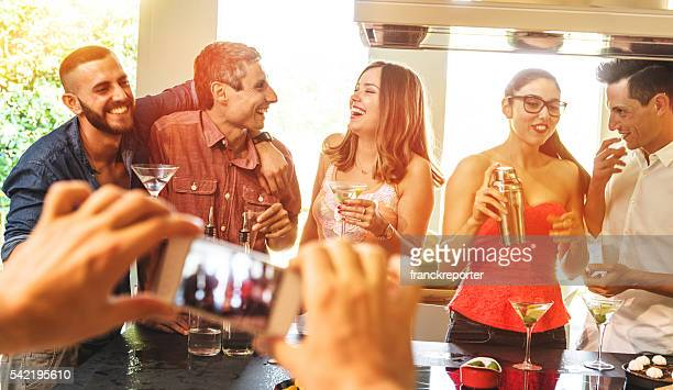 group of friends toasting with drinks