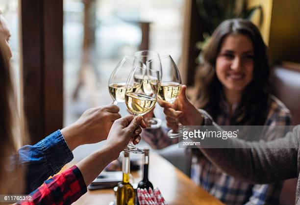 group of friends toasting with wine glasses - white wine stock pictures, royalty-free photos & images