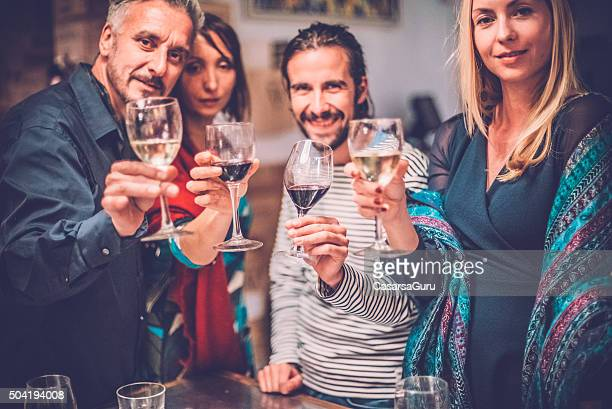 Group of Friends Toasting with Wine, Looking At Camera