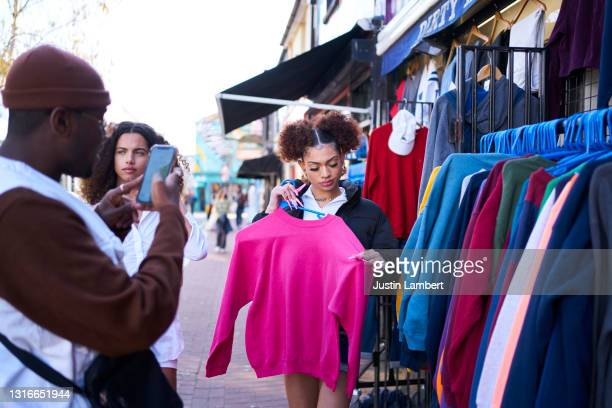 group of friends trying on vintage clothing and posing for pictures - clothing stock pictures, royalty-free photos & images