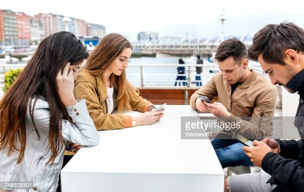 group of friends using their smartphones - addict stock photos and pictures