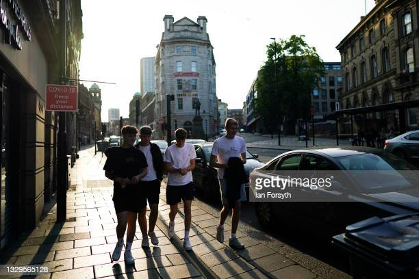 Group of friends walk along a street in Newcastle on Freedom Day on July 19, 2021 in Newcastle upon Tyne, England. As of 12:01 on Monday, July 19,...