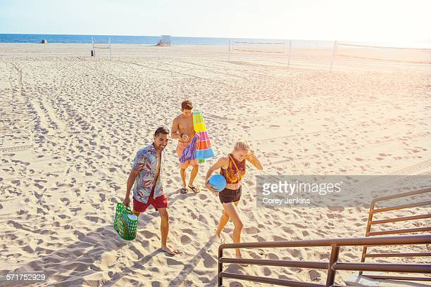 Group of friends walking away from beach