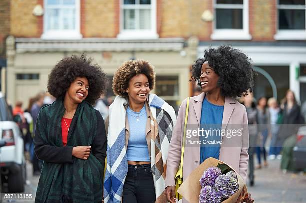 Group of friends walking down London street.