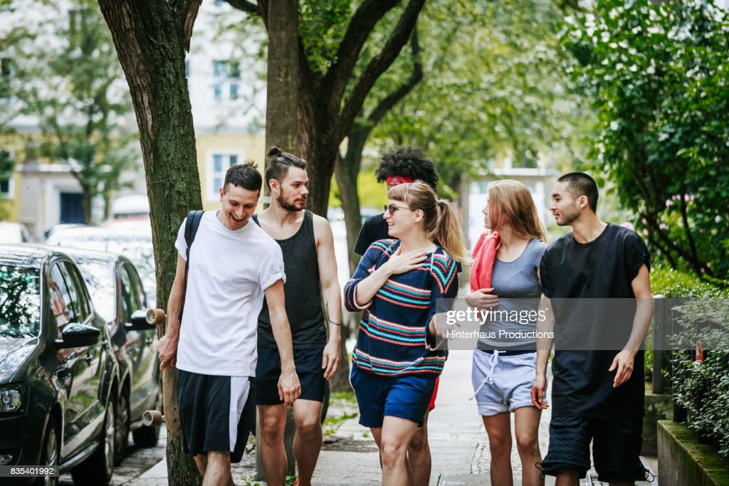 Group Of Friends Walking Home After Day Of Playing Sports ...