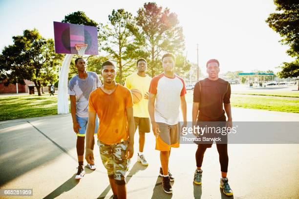 Group of friends walking off basketball court