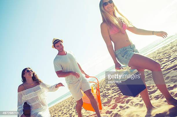 group of friends walking on the beach - esky stock photos and pictures