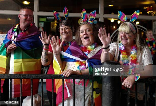 Group of friends watch as thousands of people take part in the Newcastle Pride Festival parade on July 20, 2019 in Newcastle upon Tyne, England. To...