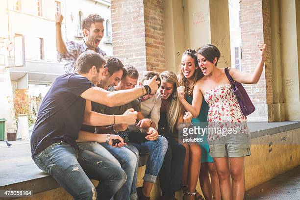 Group of friends watching sport on a digital tablet