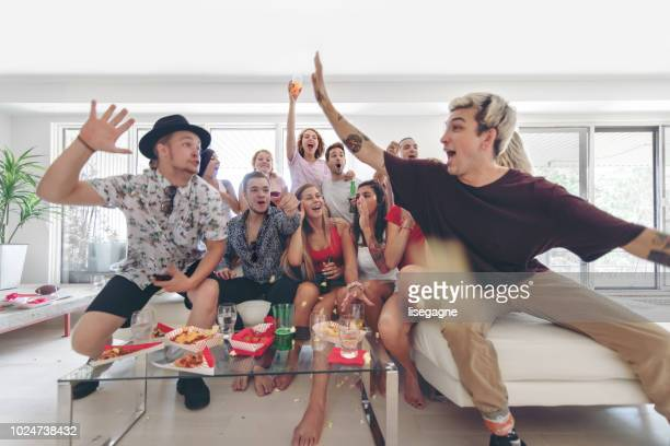 Group of Friends watching sport on TV