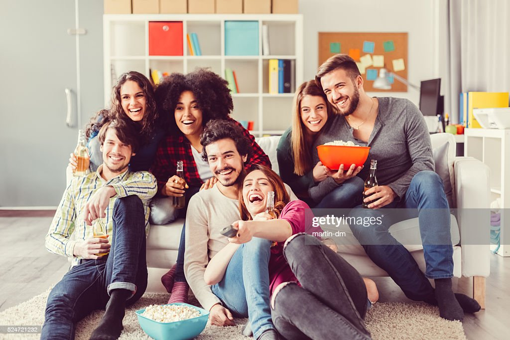 Group of friends watching tv : Stock Photo