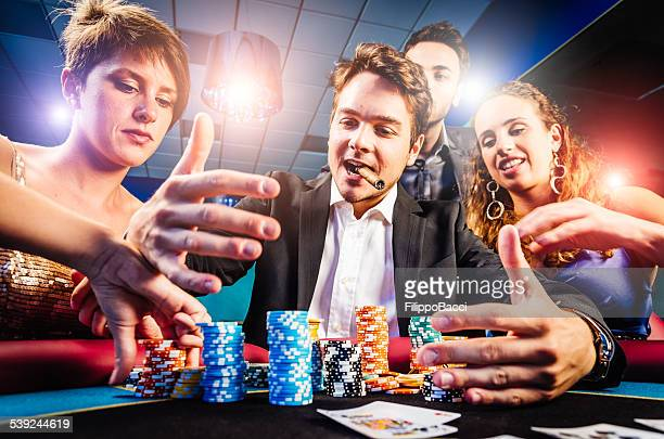 group of friends winning at casino - texas hold 'em stock pictures, royalty-free photos & images