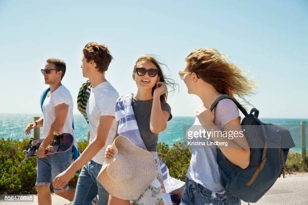 group of friends with a surf van by the sea - 麦わら帽子 ストックフォトと画像