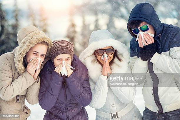group of friends with colds how blowing noses in winter - cold virus stock pictures, royalty-free photos & images