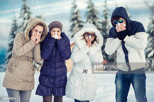group of friends with colds how blowing noses in winter - tree man syndrome stock photos and pictures