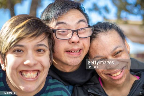 group of friends with intellectual disabilities - developmental disability stock photos and pictures