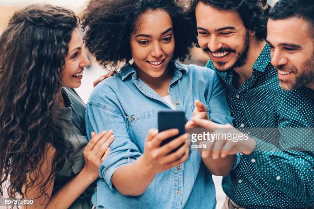 Group of friends with mobile phone