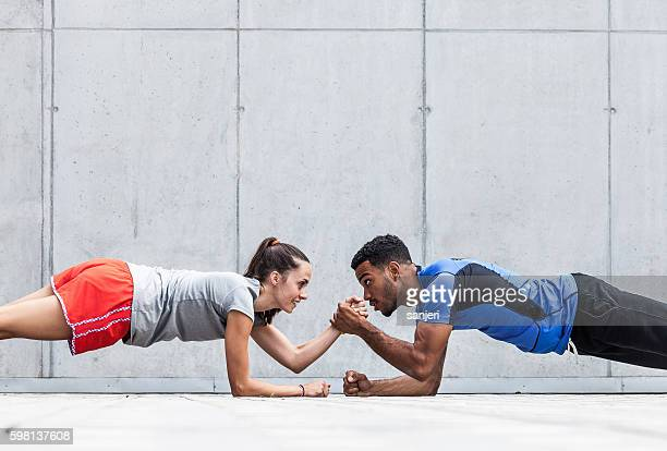 group of friends working out together - plank position stock pictures, royalty-free photos & images
