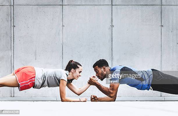 group of friends working out together - warming up stock pictures, royalty-free photos & images